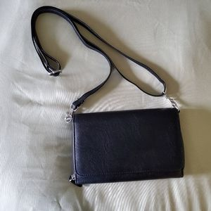 Safe keeper cross body purse NEW with out tags
